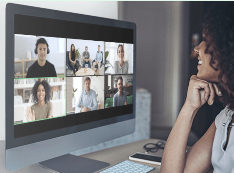 woman watching a zoom video conference
