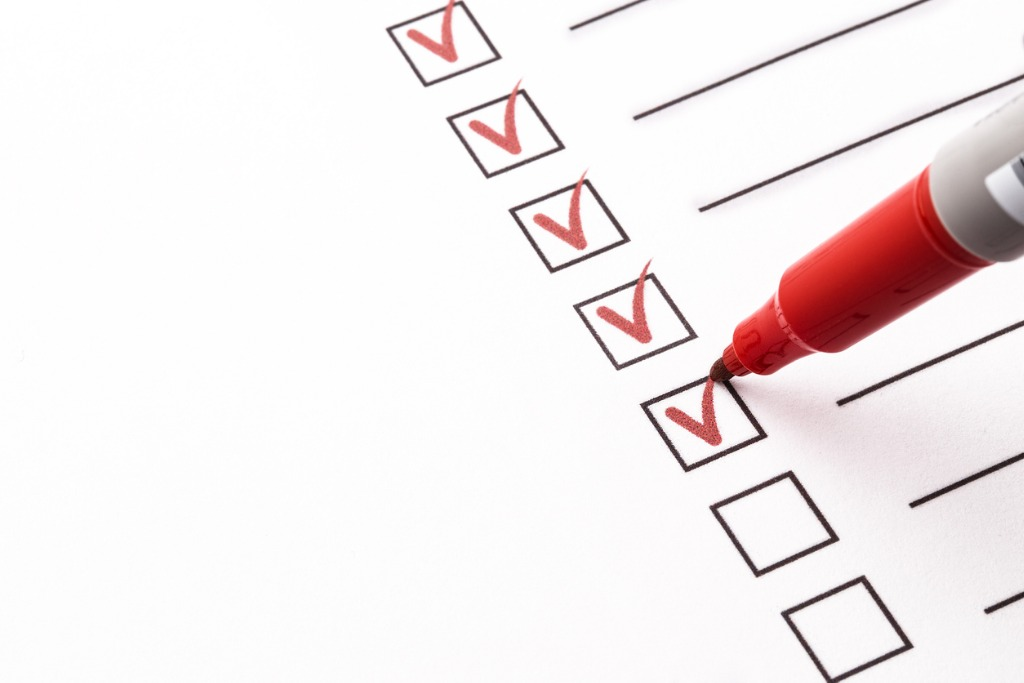 red marker checks off boxes of to-do list